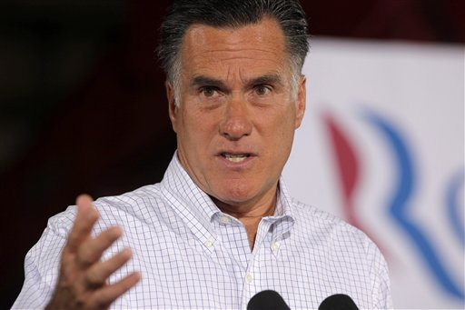 Republican presidential candidate Mitt Romney says that including charity contributions he's given up more than 20 percent of his income annually.