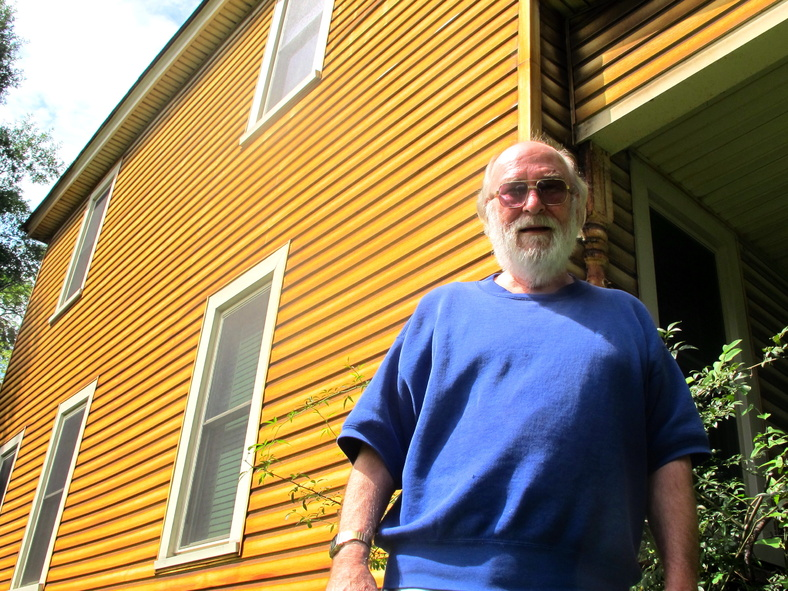 Paul Skoko stands outside his house in Georgetown, S.C., which shows the discoloration caused by emissions from a nearby steel mill. He was one of a group of local residents who brought a pollution suit against GS Industries, operator of the mill, back in 1998 when the company was owned by the company Mitt Romney co-founded, Bain Capital.