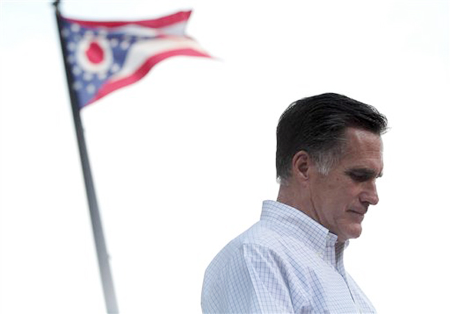 The Ohio state flag flies in the background while Republican presidential candidate Mitt Romney speaks during a campaign event at the Ross County Court House on Tuesday in Chillicothe, Ohio.