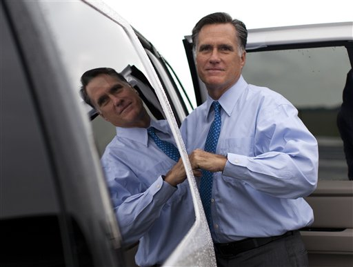 Republican presidential candidate, former Massachusetts Gov. Mitt Romney gets into his car to attend a fundraising event on Saturday, Aug. 18, 2012 in Nantucket, Mass. The Associated Press photo