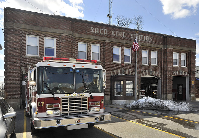 A Saco firefighter backs a truck into the Central Fire Station on the last day of its occupancy in 2011.