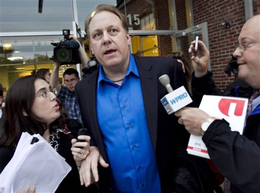 Former Boston Red Sox pitcher Curt Schilling departs the Rhode Island Economic Development Corporation headquarters in Providence, R.I., in May after he met with the agency to discuss the finances of his troubled video company.