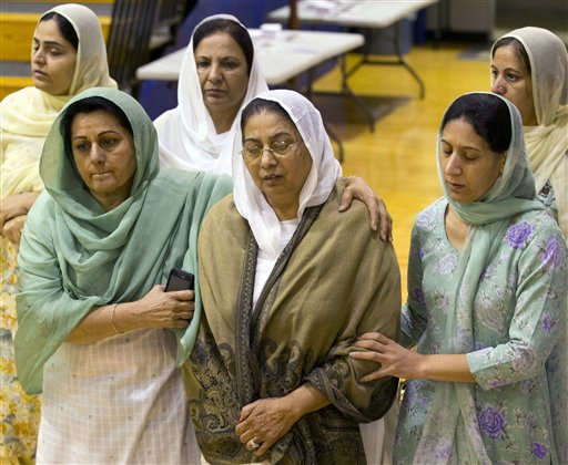 Mourners grieve at the funeral and memorial service for the six victims of the Sikh Temple of Wisconsin mass shooting in Oak Creek, Wis., today.
