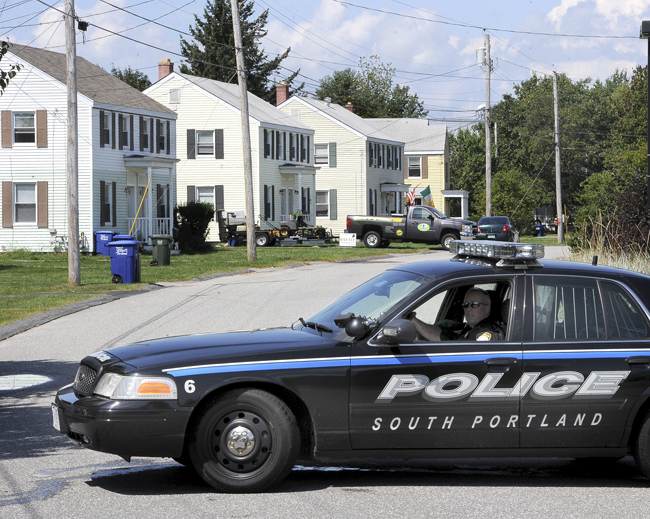 A police standoff ended peacefully at about 12:30 p.m. Tuesday in the Redbank neighborhood of South Portland. Police evacuated houses near 108 Macarthur Circle West, the second duplex from left.