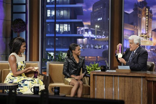 "First lady Michelle Obama, left, Olympic gold medalist Gabby Douglas chat with host Jay Leno during ""The Tonight Show with Jay Leno"" on Monday."