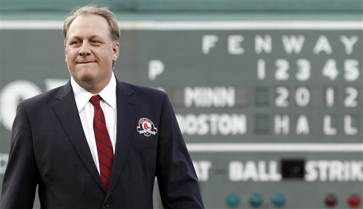 Former Boston Red Sox pitcher Curt Schilling looks on after being introduced as a new member of the Boston Red Sox Hall of Fame in this Aug. 3, 2012, photo.