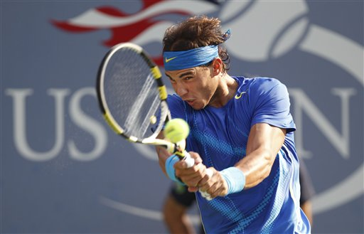 Rafael Nadal of Spain returns a shot to Novak Djokovic of Serbia during the men's championship match at the U.S. Open tennis tournament in New York in this Sept. 12, 2011, photo.
