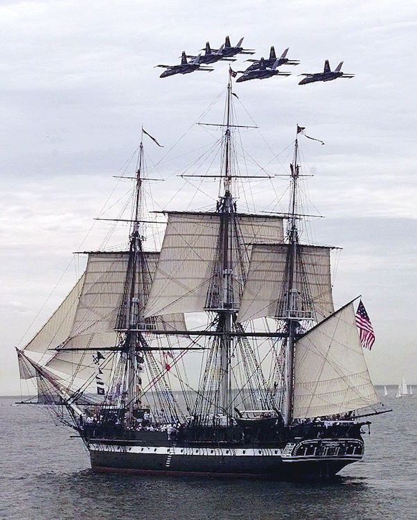 In this July 21, 1997 file photo, the Blue Angels fly in formation over the USS Constitution as she free sails off the coast of Marblehead, Mass., in celebration of her 200th birthday. The frigate, nicknamed
