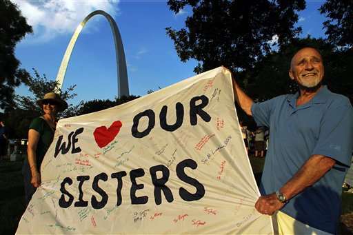 Joe Koerner and his wife Maria Allen Koerner, of St. Louis, rally with other supporters of The Leadership Conference of Women Religious (LCWR) at a vigil on Thursday in St. Louis.