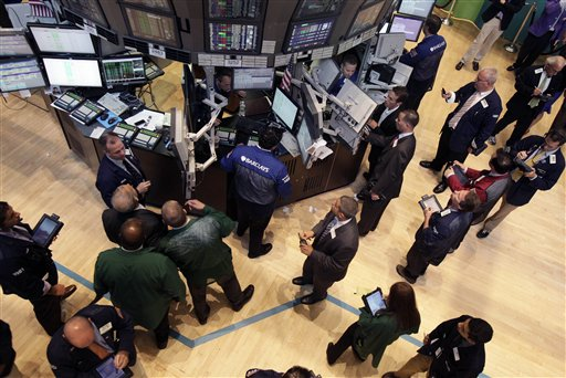 Traders and floor officials gather at a post on the floor of the New York Stock Exchange. U.S.-traded Chinese companies have faced scrutiny after auditors for several quit and others were accused of accounting irregularities. Concerns about company finances have cost investors several billion dollars.