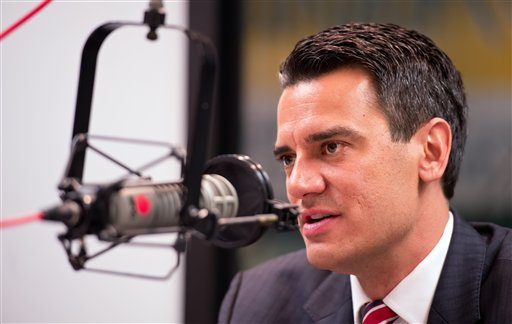 "U.S. Rep. Kevin Yoder, R-Kan., apologizes to his constituents on the air during the ""Up To Date"" radio show on KCUR-FM on Monday morning, in Kansas City, Mo., after a published report revealed that the freshman lawmaker swam nude in the Sea of Galilee during a private fact-finding trip to the Mideast last August."