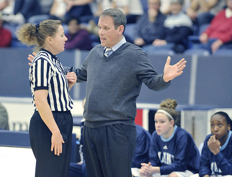 "Richard Barron, the University of Maine women's basketball coach, asks for a referee's help in deciphering a call in a game late last year in Orono. Going to Europe to recruit ""was out of necessity more than anything,"" the coach said."