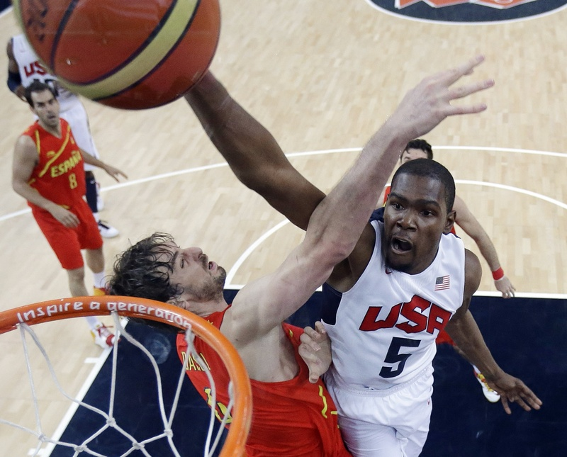 United States' Kevin Durant (5) slam dunks to score over Spain's Pau Gasol, left, during the men's gold medal basketball game at the 2012 Summer Olympics on Sunday.