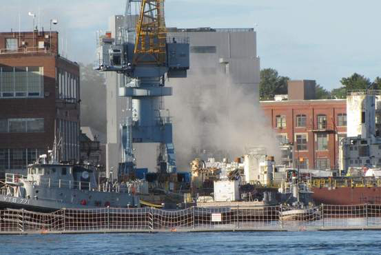 Smoke billows from the USS Miami, a nuclear submarine docked in Kittery, after a fire broke out in the sub's forward compartment on May 23.