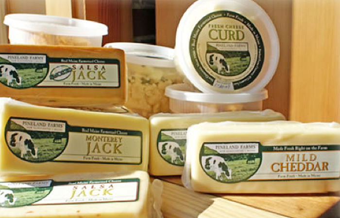 A display of Pineland Farms cheeses.