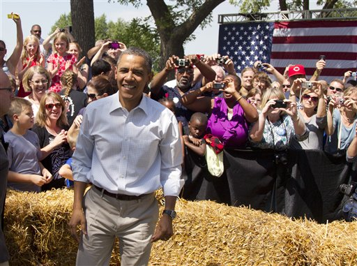 President Barack Obama attends a campaign event at the Nelson Pioneer Farm & Museum, Tuesday, Aug. 14, 2012, in Oskaloosa, Iowa, during a three day campaign bus tour through Iowa. (AP Photo/Carolyn Kaster)