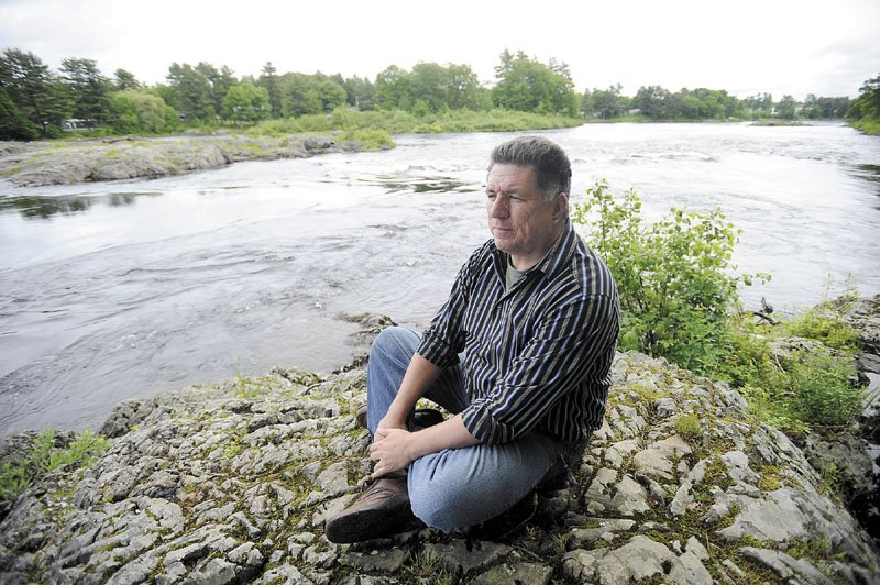 In this June 2012 file photo, James Eric Francis Sr., a tribal historian with the Penobscot Nation, looks over the Penobscot River from land on Indian Island.