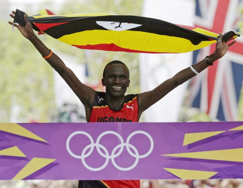 Stephen Kiprotich of Uganda celebrates as he crosses the finish line to win the men's marathon at the 2012 Summer Olympics in London Sunday.