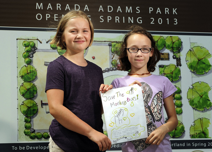 Sadie Ouillette, 9, left, and Natasha Malia, 10, are upset that monkey bars aren't in the plans for a new playground being built by the former Adams School.