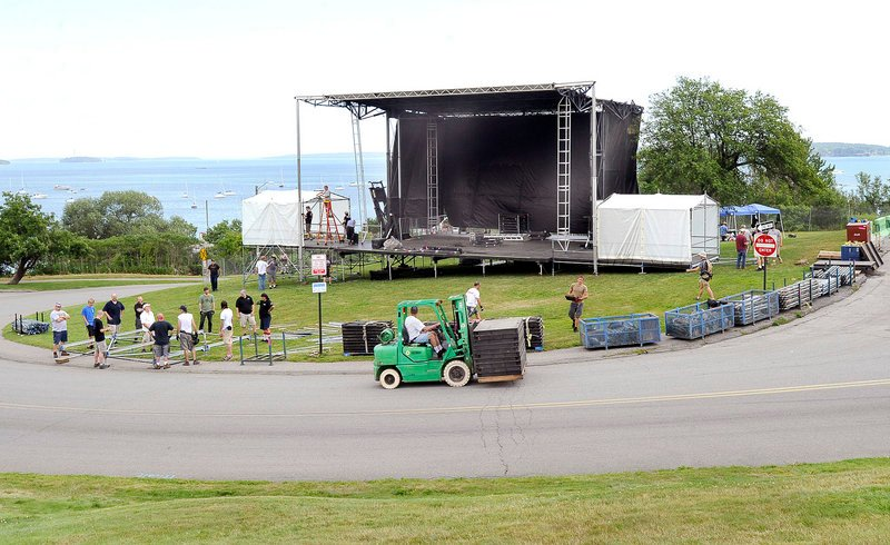 Workers set up the stage Wednesday for the Mumford & Sons concert on Saturday on the Eastern Prom in Portland.