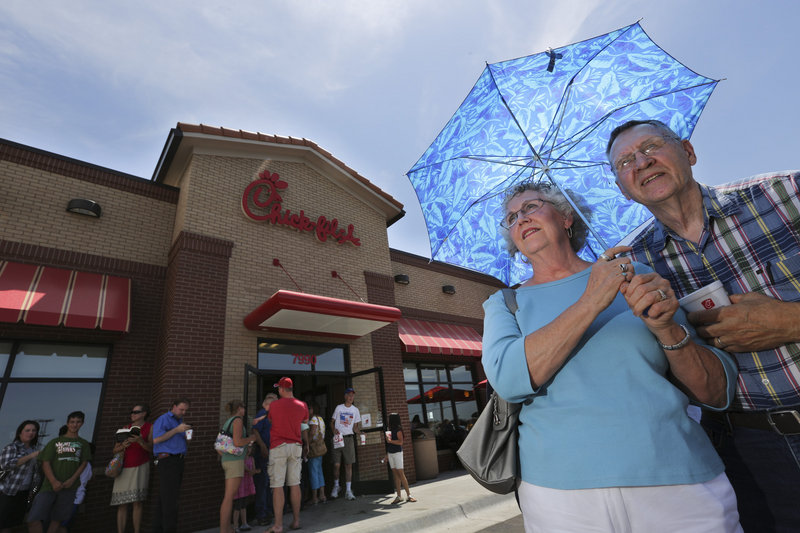 Brenda and Don Nichols wait in line at a Chick-fil-A in Wichita, Kan., on Wednesday. More than 200 people waited in line to buy a meal and show support for the company that's embroiled in a controversy over same-sex marriage.