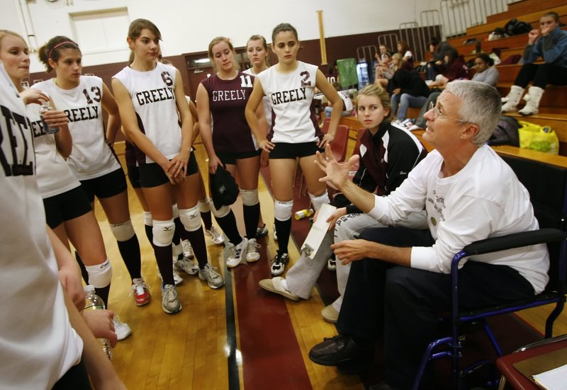 Churchill talks to the Greely High School volleyball team during a game in 2009. He coached for 11 seasons. Churchill, a popular obstetrician/gynecologist, died Monday.