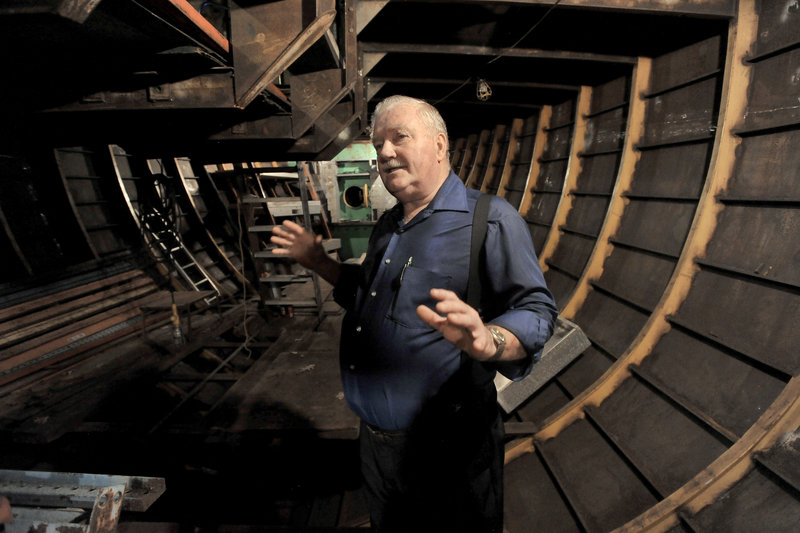 """Harold Arndt of Freeport stands below deck in the schooner he's building. He has asked the Town Council to renew a 2004 consent agreement that runs out at the end of the year. """"I can imagine it,"""" he said of the prospect of setting sail. """"I've been on enough boats."""""""