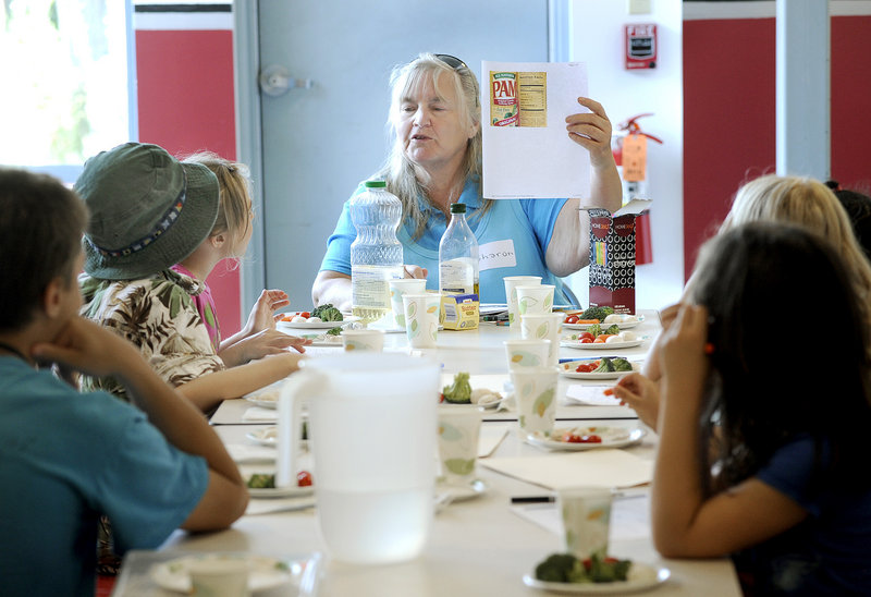 Sharon Schulberger, left, teaches a CATCH Healthy Habits program at the South Portland Boys & Girls Club recently.