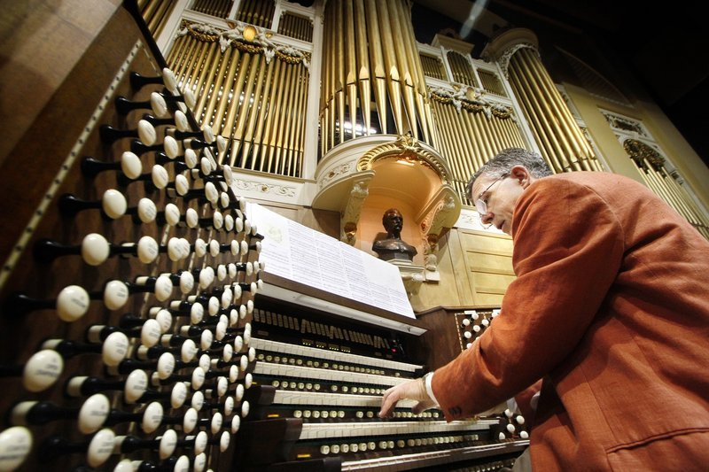 Ray Cornils, municipal organist for Portland, plays the Kotzschmar at Merrill Auditorium last year. After a gala concert marking its centennial on Aug. 22, the city's huge pipe organ will be silenced for up to 18 months as it is disassembled and refurbished.