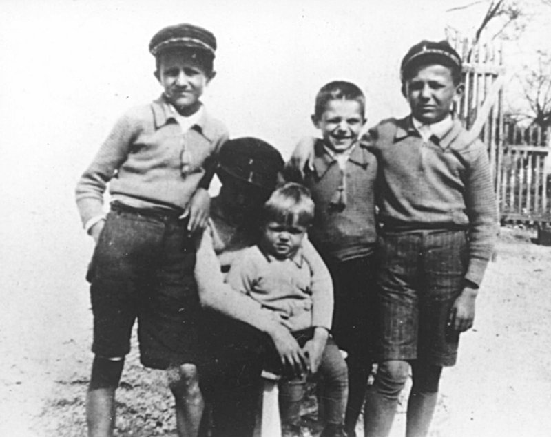 Schoolboy Veselin Kesich, right, with his three brothers and a friend in Banja Luka, former Yugoslavia, in the 1930s.