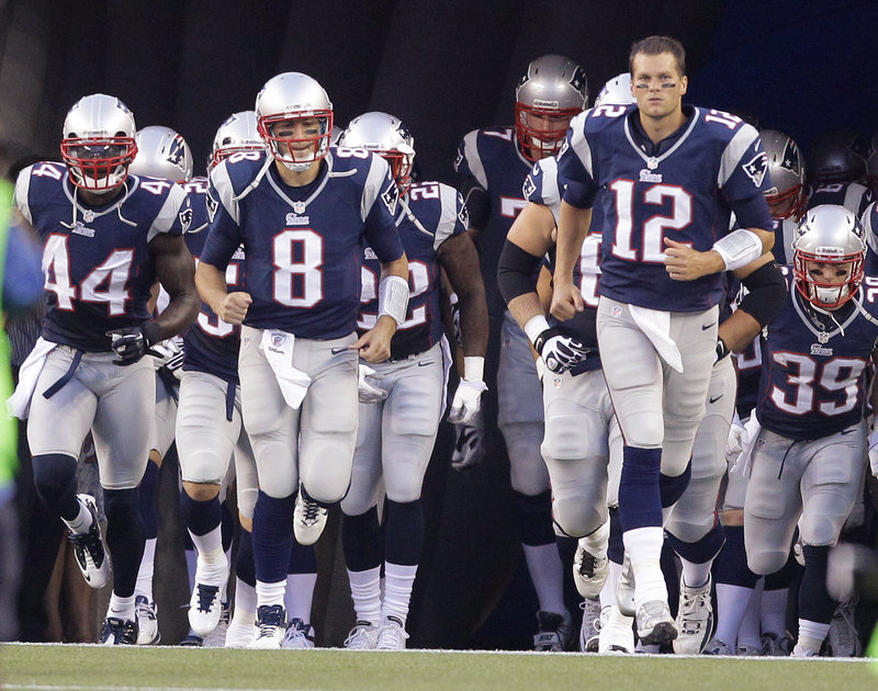 Tom Brady leads the charge of the Patriots as they take the field before their preseason game against the New Orleans Saints on Thursday night at Foxborough, Mass.