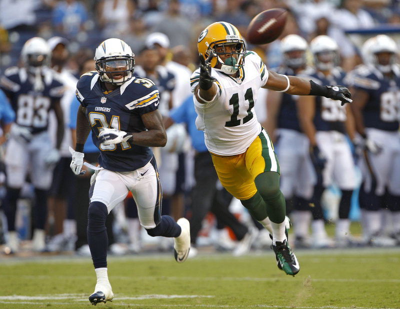 Jarrett Boykin of the Green Bay Packers stretches but can't haul in a pass Thursday night while defended by Gregory Gatson of the San Diego Chargers during San Diego's 21-13 win.