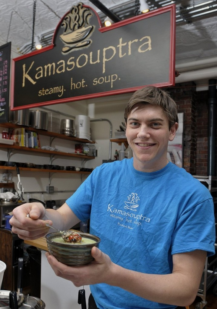 Drew Kinney, a co-owner at Kamasouptra in the Public Market House in Portland, displays one of the shop's soup varieties.
