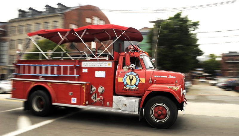 The International Harvester, which stops at the Spring Street Fire Museum on Wednesday and Friday afternoons, makes its way along Commercial Street.