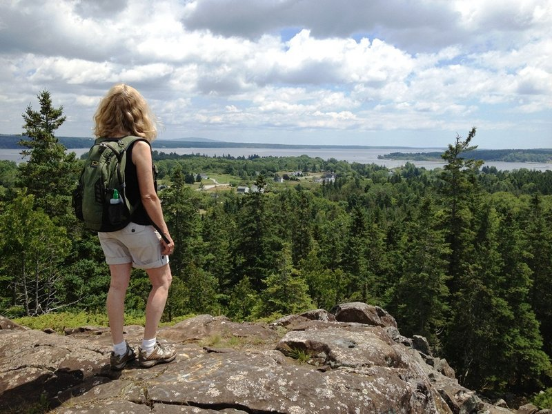 The summit at Pine Hill, part of Little Deer Isle, offers scenic views extending to Mount Desert Island and Isle au Haut.