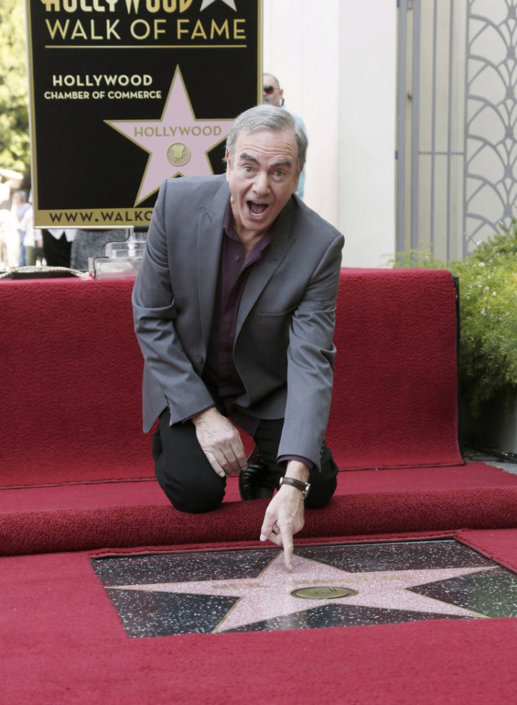 """I am,"" he cried. Singer Neil Diamond attends a ceremony honoring him with a star on the Hollywood Walk of Fame on Friday in Hollywood. His career spans five decades."