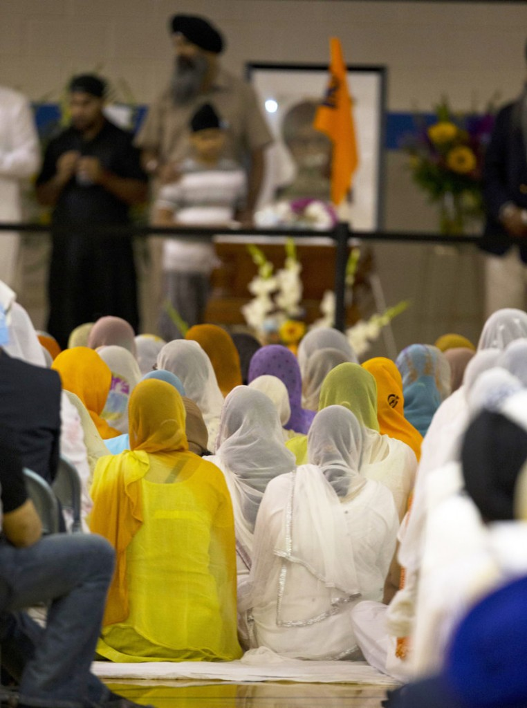 Mourners attend the memorial service for the six victims of the Sikh temple mass shooting in Oak Creek, Wis., Friday in the Oak Creek High School gymnasium. Three other people were wounded in the shooting last Sunday.