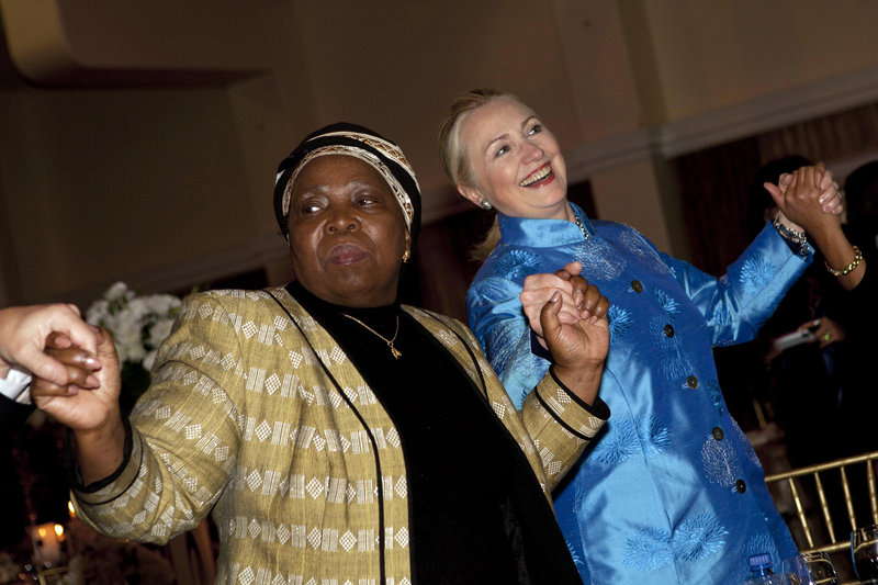 Secretary of State Hillary Clinton dances Tuesday with other officials, including African Union Chair-Designate Nkosazana Dlamini-Zuma, during a gala dinner in Pretoria, South Africa. Video of Clinton's dancing went viral online.