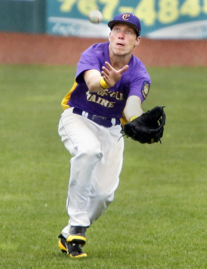 Right fielder Cam Mullen of First Title keeps his eyes on the ball while making a running catch in the rain against Saratoga, N.Y., in the seventh inning Friday. First Title won, 10-1.