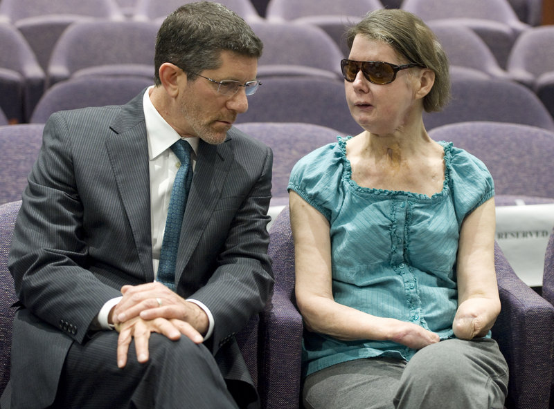 Charla Nash, right, talks with attorney Matthew D. Newman before a hearing in Hartford, Conn., on Friday. Nash, who was mauled in a 2009 chimpanzee attack, was attending the hearing to determine whether she may sue the state for $150 million in claimed damages.