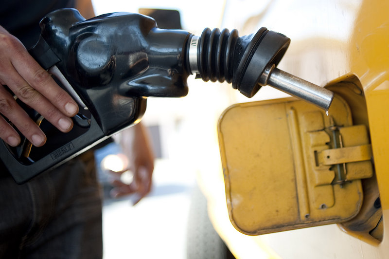 A man pumps gas into his dual-tank pickup truck at a station in Los Angeles on Friday. California drivers have seen gas climb 13 cents since a refinery fire in Richmond, Calif., on Monday.
