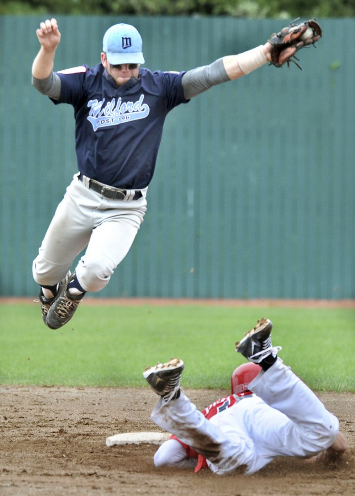 Alexander Pernick of Barnstable, Mass., slides into second with a stolen base Saturday as Christian Baglini of Milford, Conn., takes the throw. Milford won, then later beat First Title.
