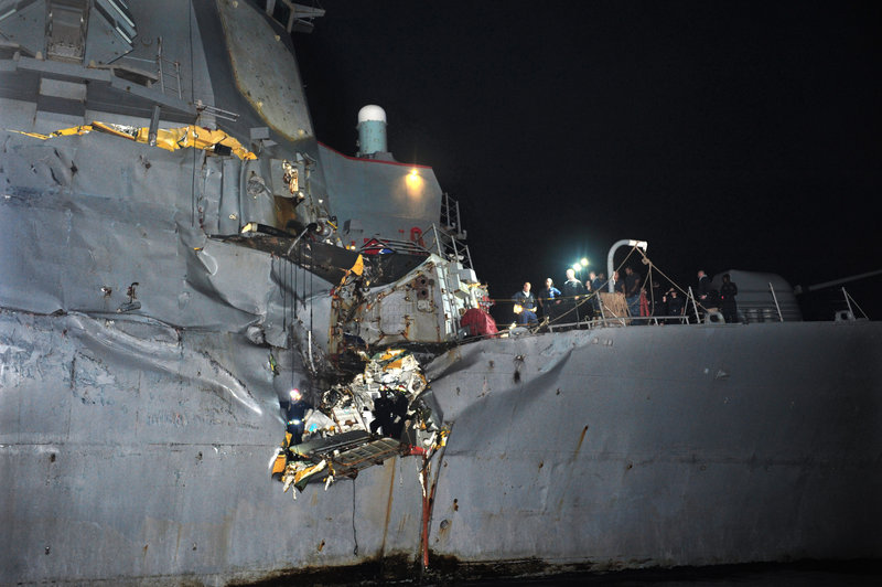 The USS Porter, a Navy guided missile destroyer, shows damage after it collided with a Japanese-owned oil tanker just outside the strategic Strait of Hormuz on Sunday. The collision left a gaping hole in the starboard side of the ship.