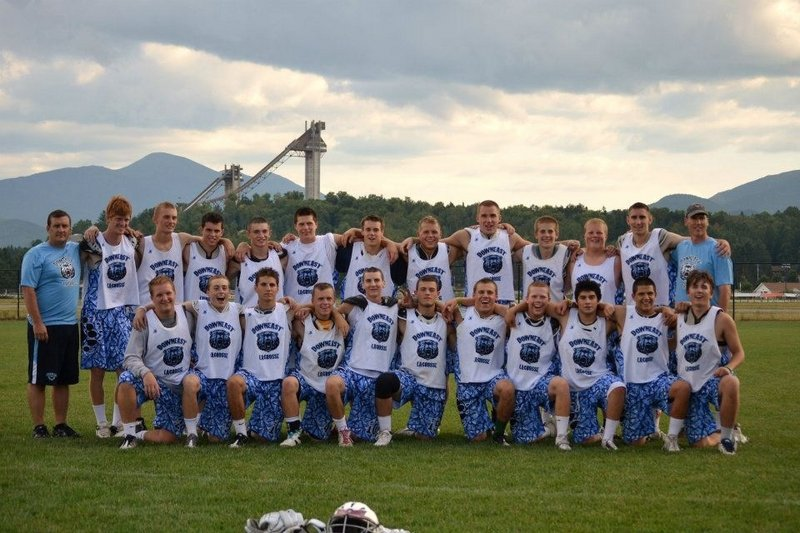 The Downeast Lacrosse team recently completed its summer schedule with a 15-3-1 record, including a 4-1 record at the Lake Placid Summit Lacrosse Classic. Team members, from left to right: Front row – Ben Bath (Kennebunkport), Tyler Jordan (Falmouth), Josh Cyr (Saco), Austin Doody (Scarborough), Christian Neelon (Scarborough), Brett Levasseur (Saco), Jake Desrochers (Alfred), Jack Sutton (Freeport), Jimmy Talbott (Gorham), Cody O'Brien (Moody Beach) and Peter Dyche (Freeport); Back row – Head Coach Tobey Farrington, Breandan Haley (Kennebunkport), Andrew Farrington (Scarborough), Matt Murphy (Scarborough), Corbin Cass (Alfred), Brendon Smith (Scarborough), Brad Gilbert (Falmouth), Svenn Jacobson (Cumberland), Steve Patrie (Lewiston), Pat Rimmer (Kennebunk), Nick Bath (Kennebunkport), Clayton Spang (Kennebunkport) and assistant coach Tom Talbott. Not pictured: David Crissione (Falmouth) and Charlie Fay (Falmouth).