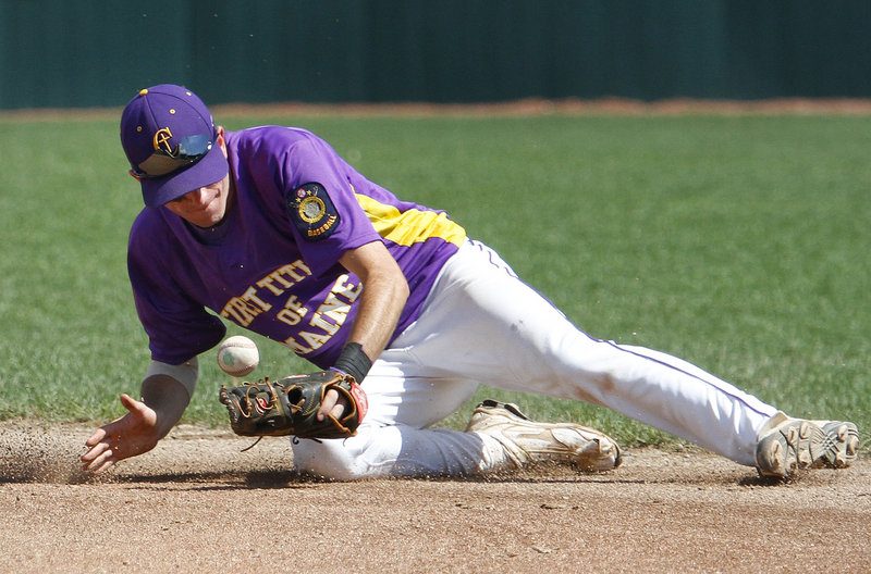 First Title second baseman Felix delVecchio knocks down a ground ball during his team's 9-1 loss to Milford, Conn.