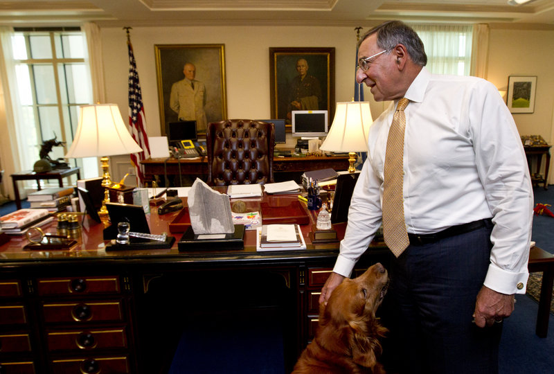 Defense Secretary Leon Panetta, with his golden retriever Bravo, speaks during an interview Monday at the Pentagon.