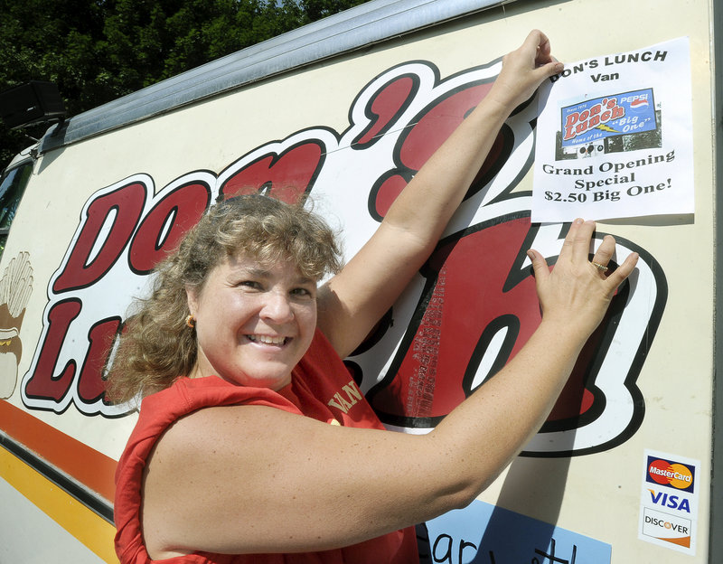 Gerri Richards displays a special, as she and her family, who are the original owners of Don's Lunch Van in Westbrook, reopen Tuesday. Don's was closed for the past couple of weeks during the transition of ownership.