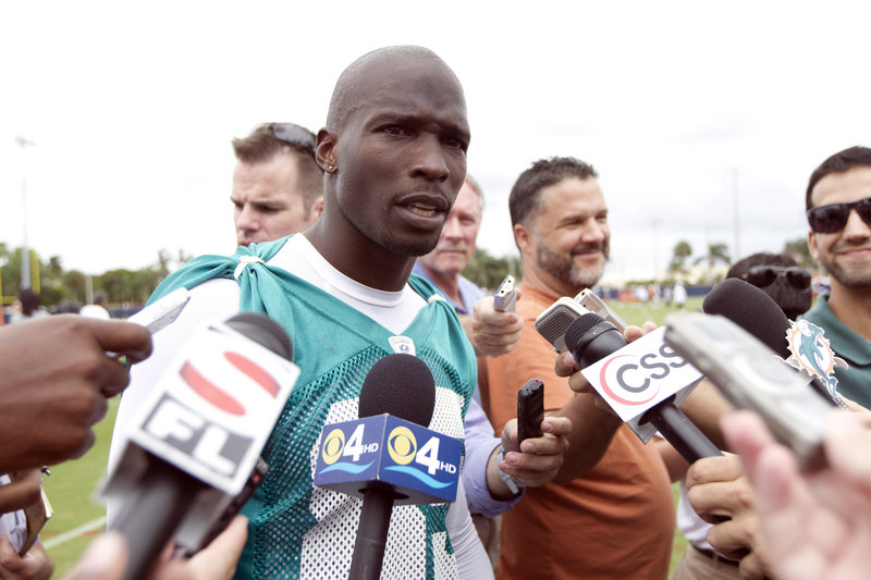 Miami Dolphin Chad Johnson, formerly known as Chad Ochocinco, talks to the media June 19 in Davie, Fla. The team dumped him a day after his arrest.