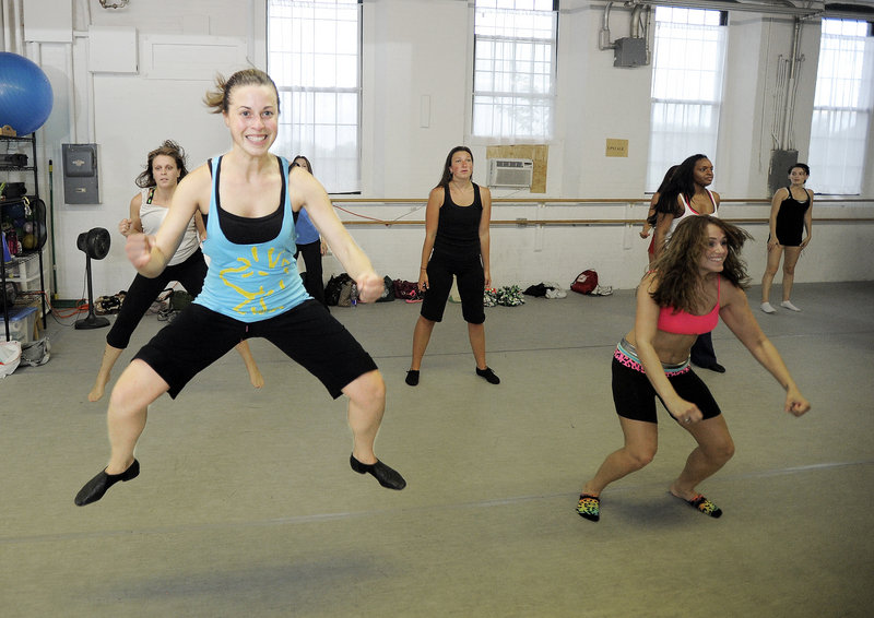 Katie Cyr of Monmouth leaps during the tryout. Cyr is an operating room nurse at Maine General Hospital in Waterville.
