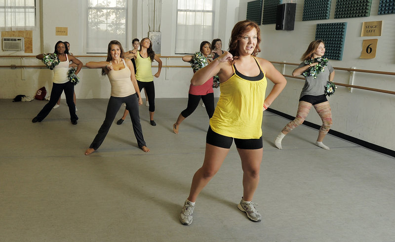 Alicia Owens of South Portland, front in yellow, leads a group of young women as they audition for the Maine Red Claws dance team Tuesday at the Drouin Dance Center in Westbrook. Final decisions will likely be made Sunday.